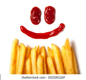 French fries  and a face with a smile from ketchup isolated on white background
