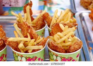 French fries and fried chicken at market