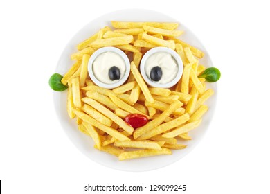 French fries with a funny face isolated on white