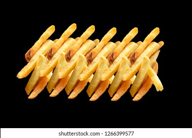 French fries isolated on black background. In concept Unhealthy food.