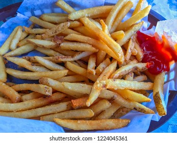 French fries with ketchup, close up
