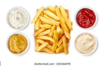 French fries with ketchup, mayonnaise, mustard and garlic dip sauce top view isolated on white background