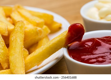 French fries with ketchup and mayonnaise sauces