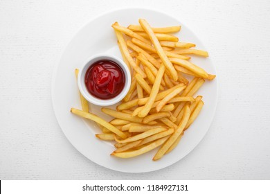 French fries with ketchup on a white plate.