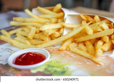 french fries with ketchup ready to be eaten close-up