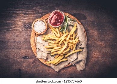 French fries with ketchup and rosemary
