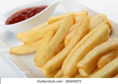 French fries with ketchup served on white dish