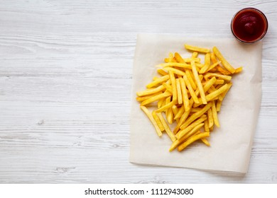 French fries with ketchup, top view. Copy space.