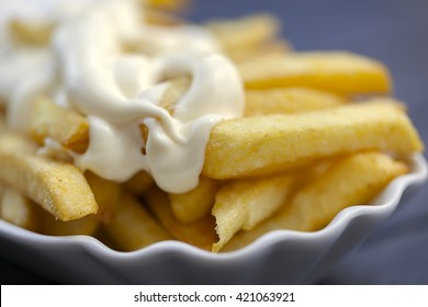 French fries with mayonnaise in a bowl, close up,