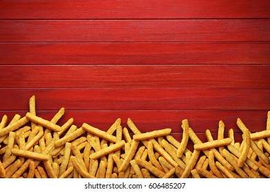 French fries on red background.