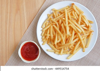 French fries on white plate with ketchup