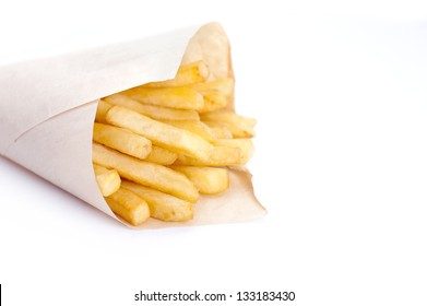 french fries in paper container over white background