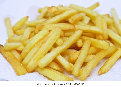 French fries put on white fat paper