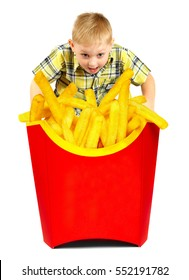 French fries in a red box. Boy looks at fast food.