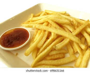 French fries with tomato ketchup on white plate. Junk Food.