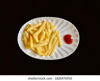 French Fries with Tomato Sauce being served in a plate