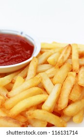 French Fries in white plate with tomato sauce