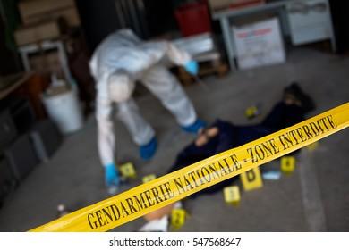 French gendarmerie forensics examining a crime scene.