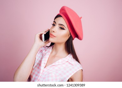 french girl with phone. parisian lady. pinup girl with fashion hair. pin up woman with trendy makeup. girl in vintage style. retro woman with moneybox. Housewife. fashion blod. phone conversation.