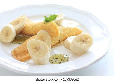 French gourmet dessert, banana and crepe on white dish