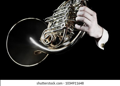 French horn player hands. Hornist playing horn music orchestra instrument closeup isolated