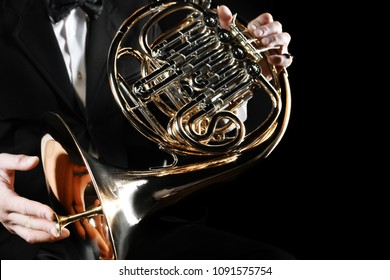 French horn player hands. Hornist playing horn music orchestra instrument