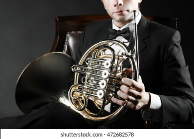 French horn player. Music instrument horn in the hands of hornist