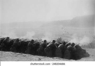 French Infantry firing from a World War 1 trench. 1914-15.