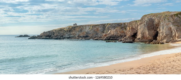 French landscape - Bretagne. Panorama of a beautiful beach with wild cliffs in the background.