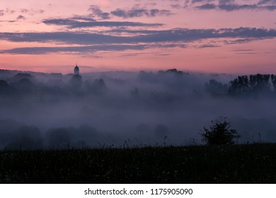French landscape - Jura.A small village in the Jura mountains after sunset covered by mist.