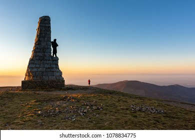 French landscape - Vosges. View from the summit of the Grand Ballon in the Vosges on the Rhine Valley and the Alps. A man is taking a photo.