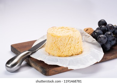 French Langres soft cows crumbly cheese with washed rind structure made in Champagne - Ardenne region