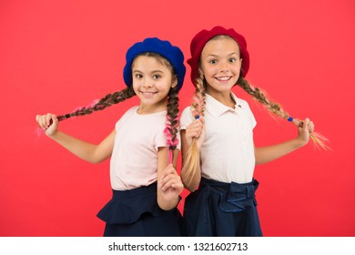 French language school. School fashion concept. Pupil smiling girls wear formal uniform and beret hats. International exchange school program. Education abroad. Apply form enter international school.