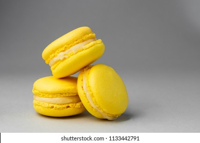 French macarons. Stack of  yellow lemon macaron on white background. Colorful macaroons
