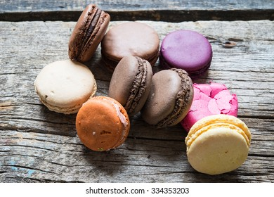 French macaroons on a wooden background