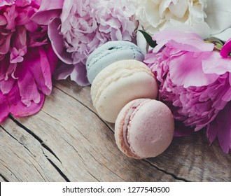 French macaroons and peony flowers