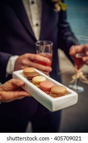 French macaroons served to people at the outdoor party