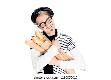 french man embracing tasty baguettes with closed eyes isolated on white