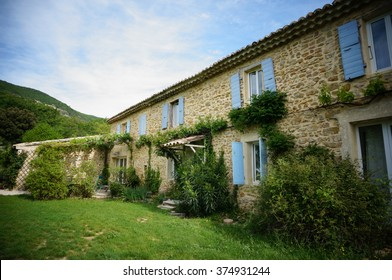 French manor house with lavender blue shutters and green.