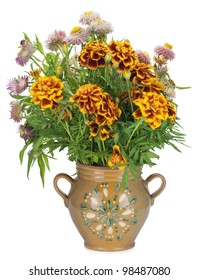 French Marigold Petite Orange (Tagetes patula) flowers in simple rural mass production ceramic clay  jug  pot isolated