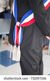 french mayor during a celebration with scarf red blue white