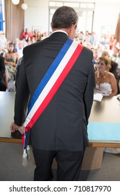 a french mayor during a wedding celebration