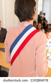 French mayor woman with a scarf flag blue wghite red during ceremony weeding day