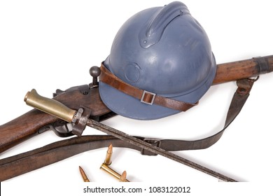 french military helmet of the First World War with rifle isolated on white background