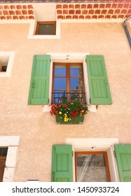 French mint green vintage window with a pot of colorful flowers and nude wall then red brick. Fits to quotes background