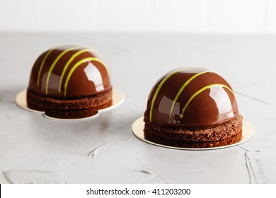 French mouse cakes with chocolate mirror glaze. Modern european desserts. Shallow focus