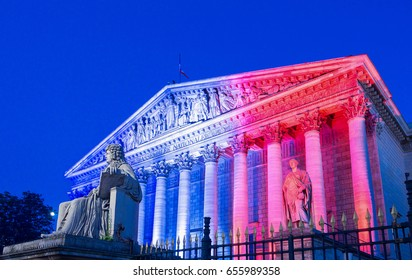 The French National Assembly lit up with colors of French national flag, Paris, France.