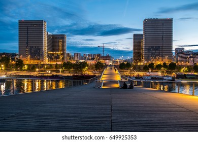 The french national library (BNF François Mitterand) by night from the passerelle Simone de Beauvoir