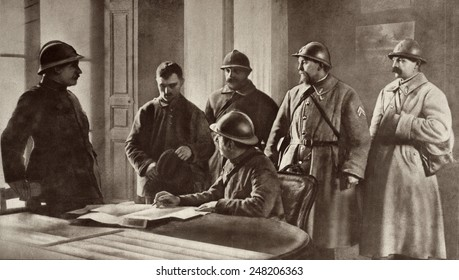 French officers interrogating a German prisoner during World War 1. Probably 1914. He was captured at Moronvilliers, France, the site of fighting in Sept 1914.