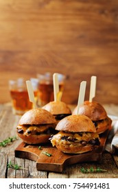 French Onion beef sliders with beer on a wood background. toning. selective focus